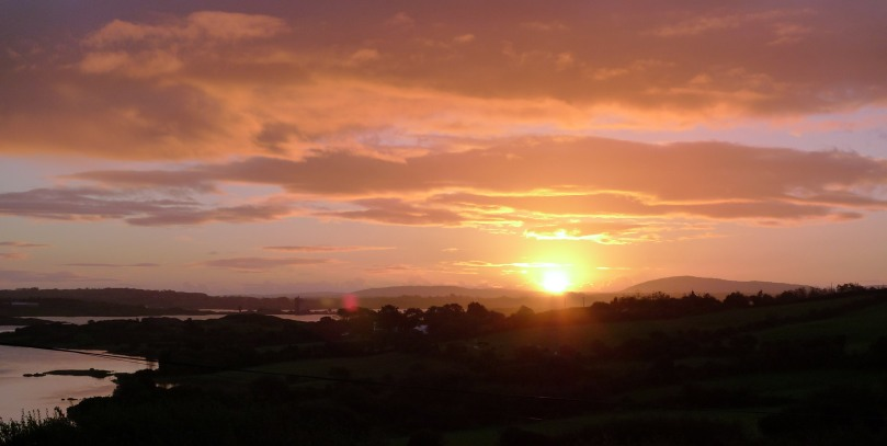 Dawn over Sherkin, seen from Ard Glas: Cape Clear is in the far distance