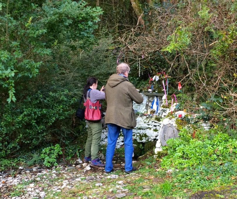 Two of the three pilgrims at a holy well