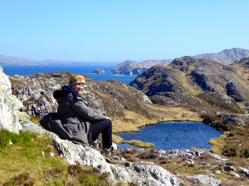 Susan at the cairn. Three Castle Head on the Mizen