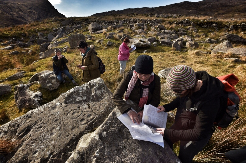 Robert, Clare, Finola, Elizabeth and Avril, checking the records and GPS readings. (Photo © Ken Williams)