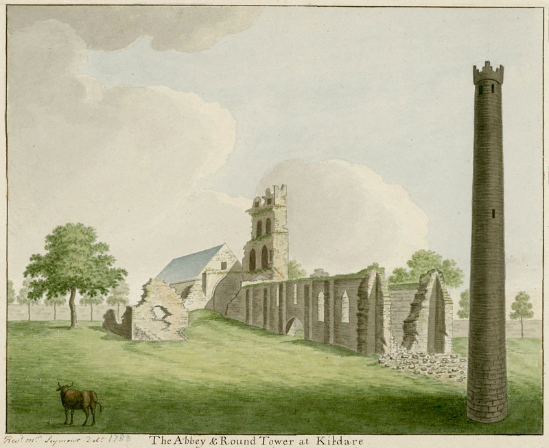 Kildare Round Tower: note the battlemented top - probably added in an 18th century restoration, the romanesque doorway and the granite base. The upper stonework is limestone and sandstone