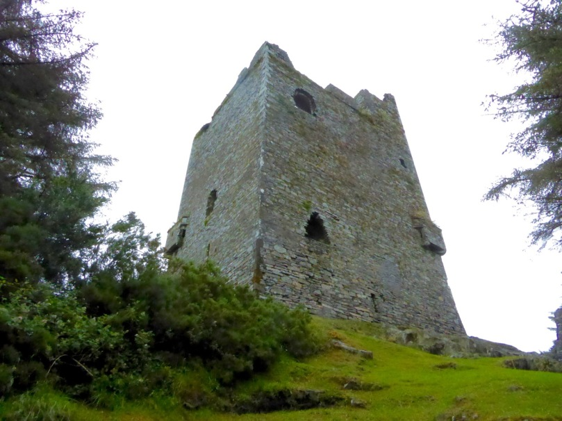 Ballinacarriga Castle. Note the splayed base batter and the unusual second floor bartizans