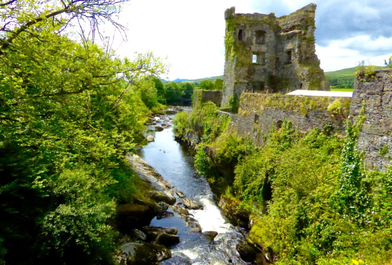 The bawn wall of Carriganass Castle at Kealkill hovers picturesquely over the river