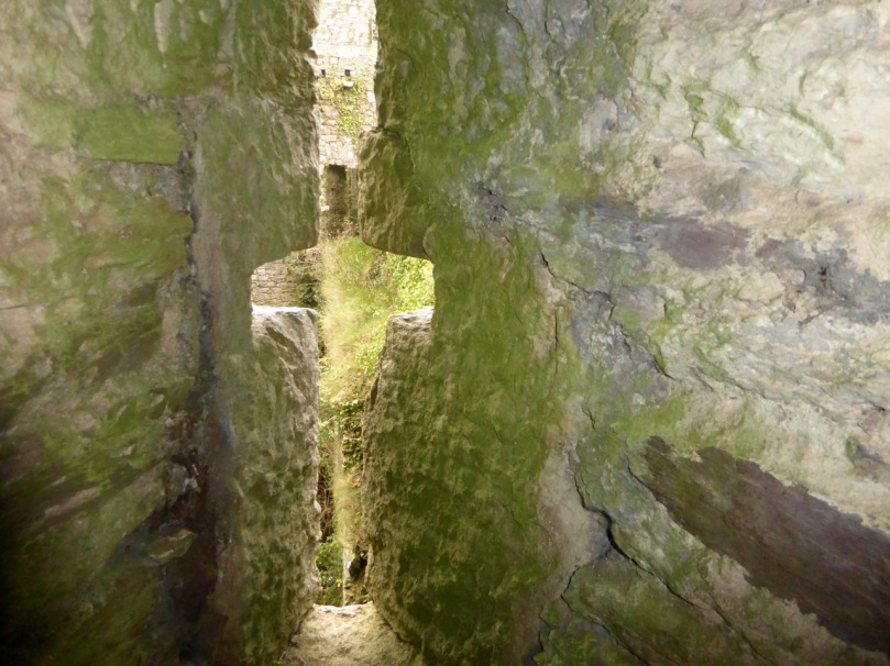 This crosslet provides light for a spiral staircase and allows an archer to shoot from inside the castle