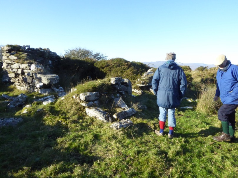 Robert and John inspect the little ruined farmhouse